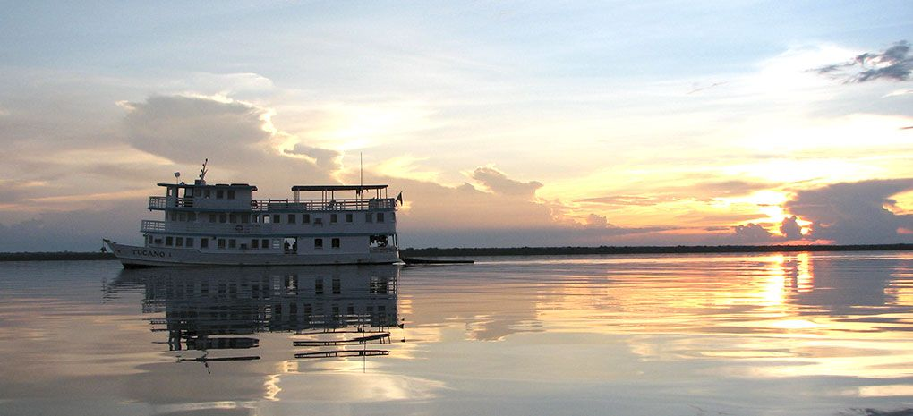 M/Y Tucano Cruising Amazon River at Sunset