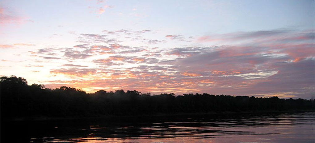sunset over the Amazon River and Rainforest as seen from the deck of the M/Y Tucano on a cruise